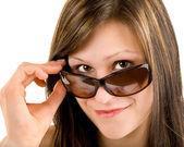Beautiful Girl Looking Over Sunglasses — Stock Photo