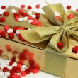 Gift Surrounded by Heart Shaped Candies — Stock Photo #2048266