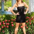 Sexy Lady Standing in Front of Tulips — Stock Photo