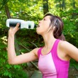 Woman Drinking Water after a Workout — Stockfoto