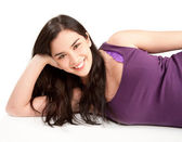 Smiling Young Woman Lying Down — Stock Photo