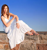 Lady Sitting on Top of a Stone Wall — Stock Photo