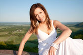 Woman in a White Dress Outdoors Posing — Foto de Stock