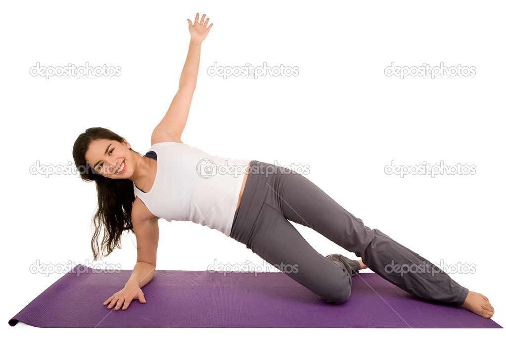 A young beautiful brunette is exercising and stretching. — Stock Photo #2047438