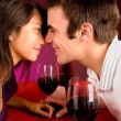 Royalty-Free Stock Photo: Couple Getting Closer While Having Wine