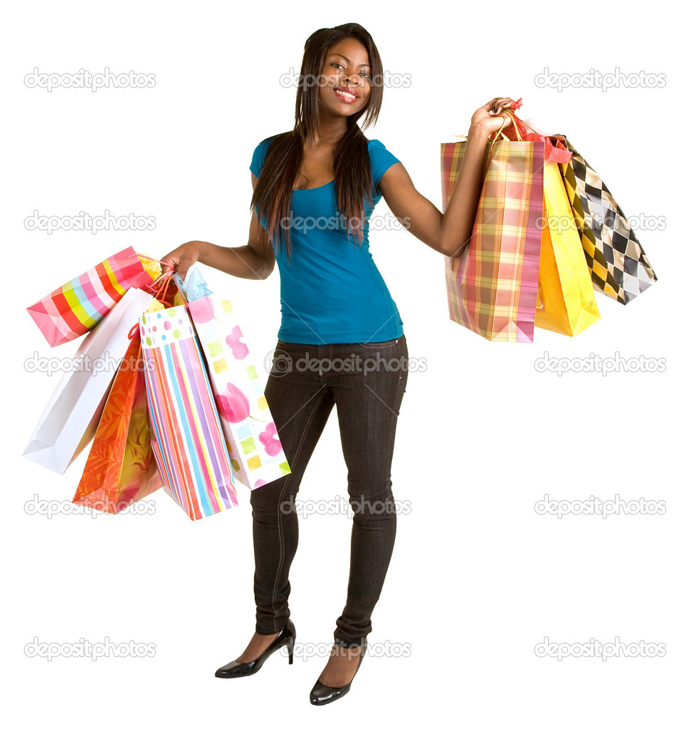 A proud young African American woman is coming back from a shopping spree. — Stock Photo #2270865