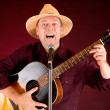 Singing and Playing Acoustic Guitar — Stock Photo