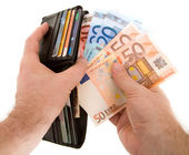 Paying Cash with Euro Currency — ストック写真