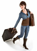Smiling Young Lady Pulling her Luggage — Stock Photo
