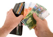 Paying Cash with Swiss Francs Currency — Stock Photo
