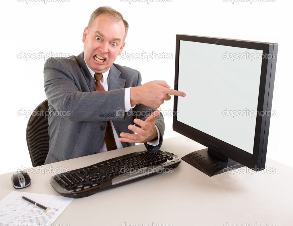 An angry middle aged businessman is pointing to the monnitor — Stock Photo #2371399