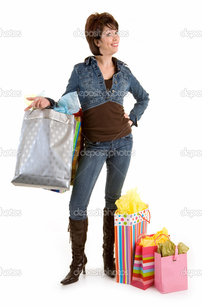 A proud young woman is coming back from a shopping spree. — Stock Photo #2372145
