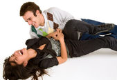 Young Girl being Tickled by Young Man — Stock Photo