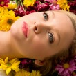 Young Woman Laying in Flowers — Stock Photo #2394807