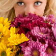 Woman's Eyes Looking Over Flowers — Stock Photo #2395563