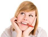 Biting on Pen While in Deep Thought — Stock Photo