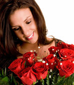 Young Brunette Admiring her Roses — Stock Photo