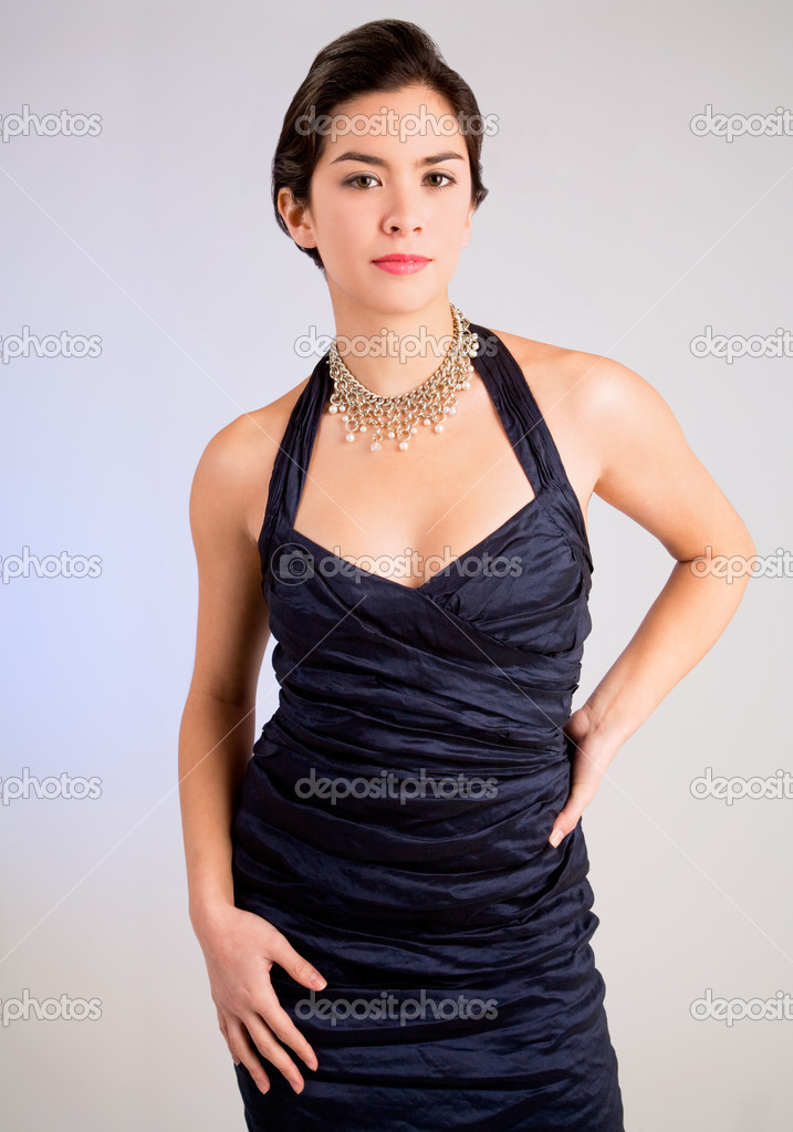 A beautiful young lady of asian descent wearing an evening gown  Stock Photo #2394316