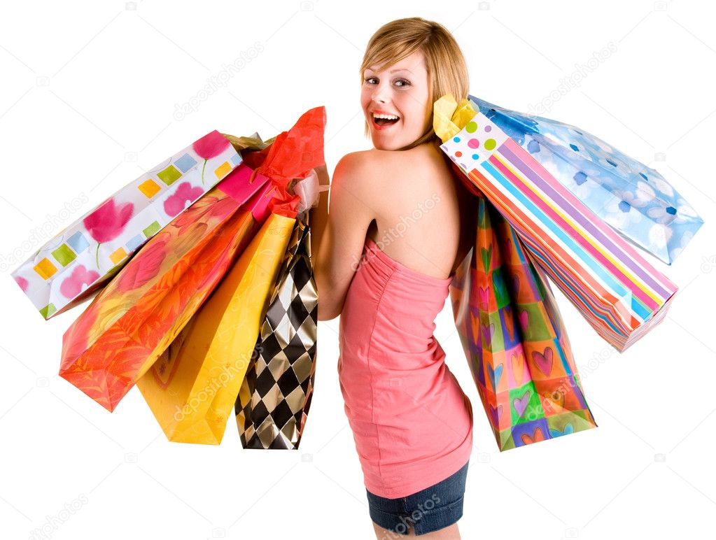 A proud young woman is coming back from a shopping spree.  Stockfoto #2395355