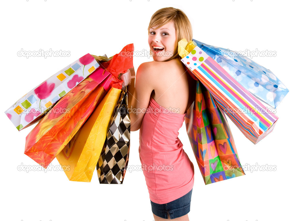 A proud young woman is coming back from a shopping spree. — Lizenzfreies Foto #2395355