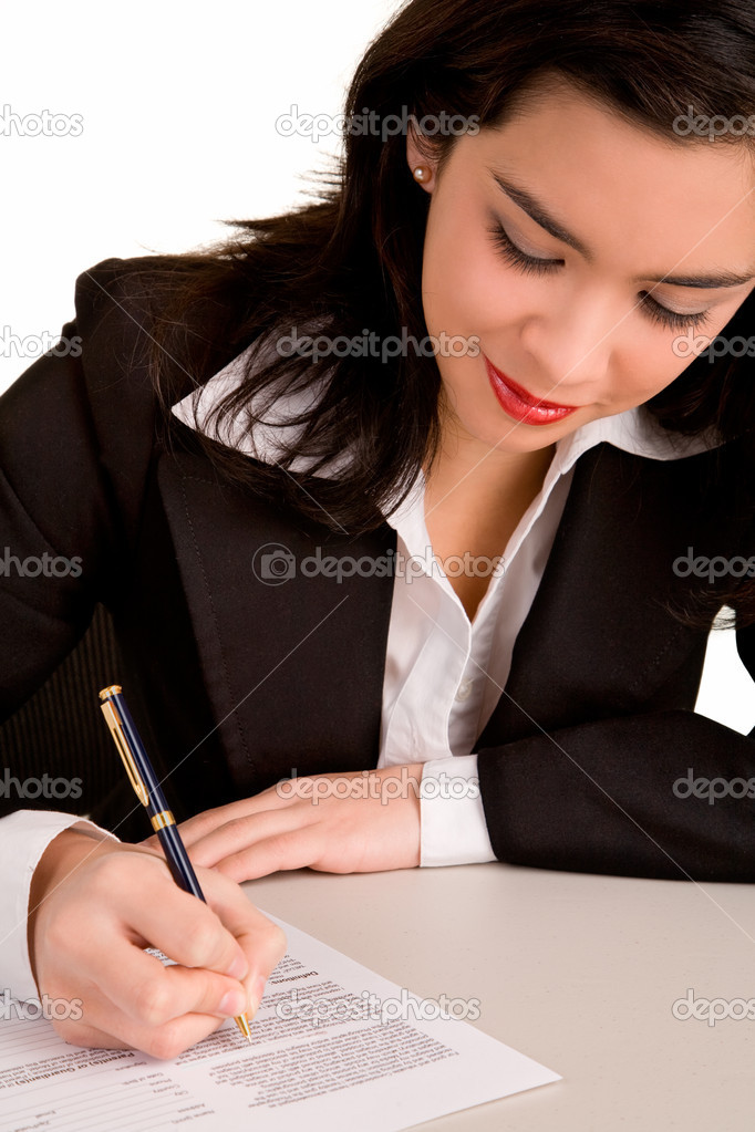 A beautiful young woman is signing a document. — Stock Photo #2395389