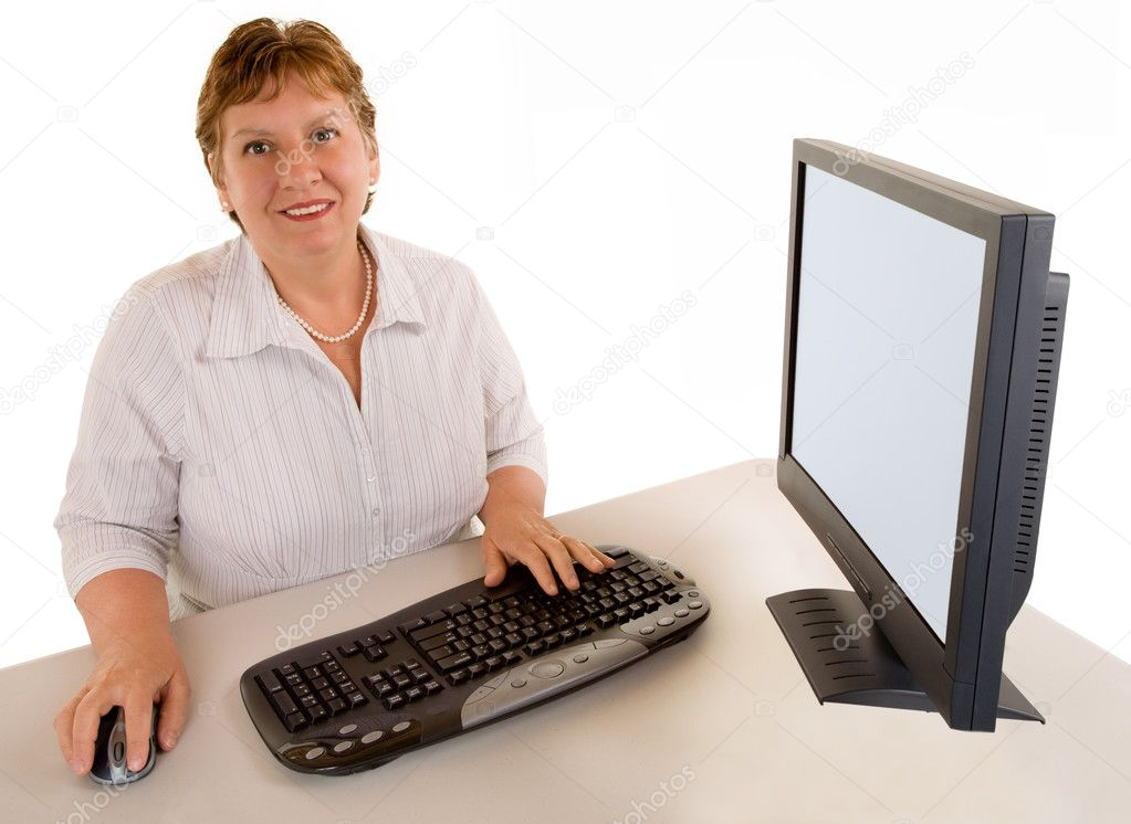 A smiling beautiful middle age businesswoman is sitting at her desk. — Stock Photo #2399720