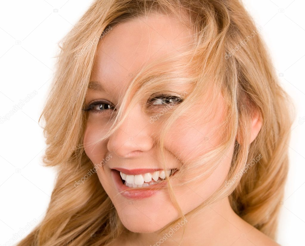 Woman's hair are being blown away in her Face — Stock Photo #2399974