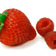 One Strawberry and Two Raspberries — Stock Photo