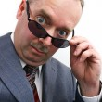 Businessman Takes Sunglasses Off — Stock Photo