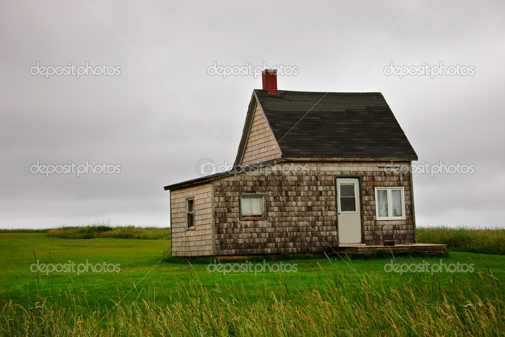 A lonely little house on Prince Edward Island, Canada.  Stock Photo #2407066