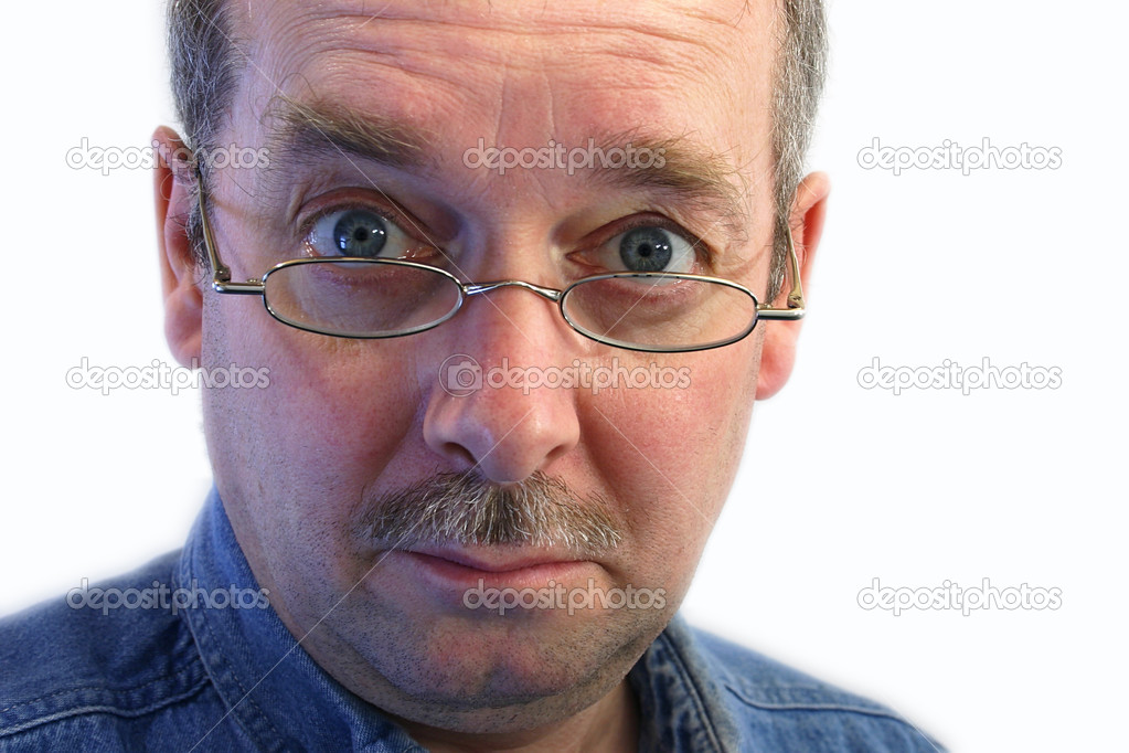 Man with glasses has a skeptical attitude.  Stock Photo #2407304