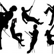 Stock Vector: Rock climbers silhouettes