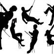 Rock climbers silhouettes — Stock Vector