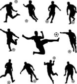 Soccer players silhouettes — Stock Vector