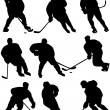 Постер, плакат: Ice hockey players silhouettes