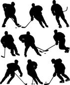Ice hockey players silhouettes — Stock Vector