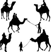 Camel riders silhouettes — Stock Vector