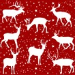 Christmas deers on the red background — Image vectorielle