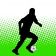 Soccer player on the abstract background — Image vectorielle