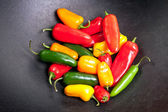 Colorful Peppers in a Cast Iron Pot — Stock Photo