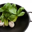 Bok Choy Stalks and Garlic in a Wok — Stock Photo #2057436