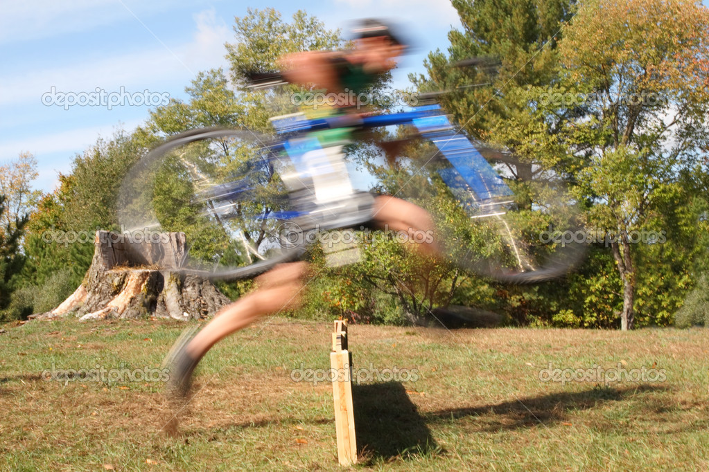 Rider running the barriers during a cyclocross bicycle race — Stock Photo #2073143