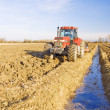 Tractor ploughs the land — Stock Photo #1973473