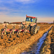 Stock Photo: Tractor plowing field