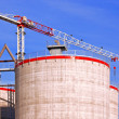 Stock Photo: Crane and silos