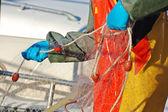 Fisherman controlling net — Stock Photo