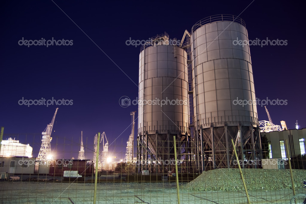 Construction site with silos by night — Stock Photo #1974557