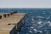 Waves against pier — Stock Photo