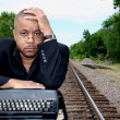 Writer on the Tracks - Stock Photo