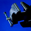 Vise on blue background — ストック写真